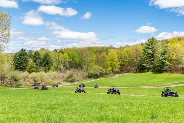 ATVs in a field